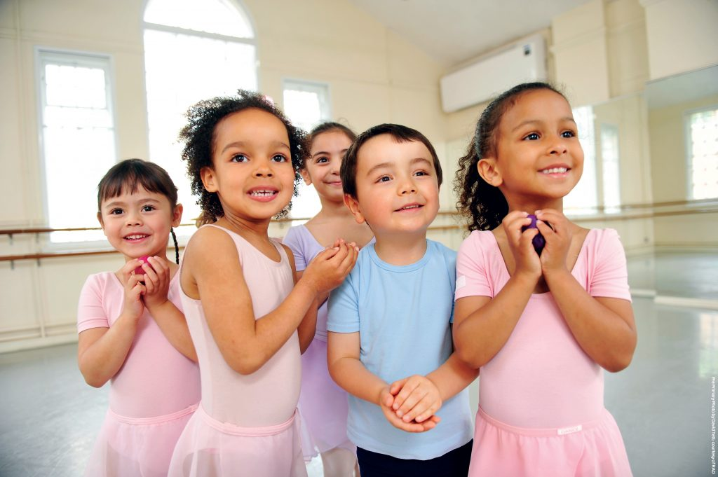 Preschool ballet class looking excited