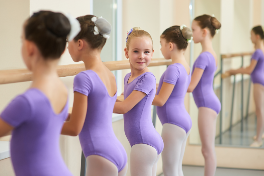 Young girls at ballet barre