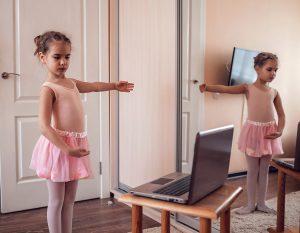 Child learning ballet online
